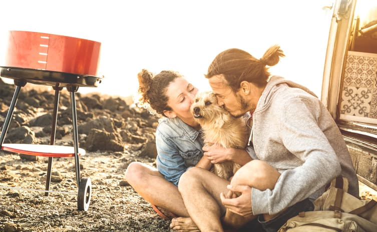 dog and couple on a campsite