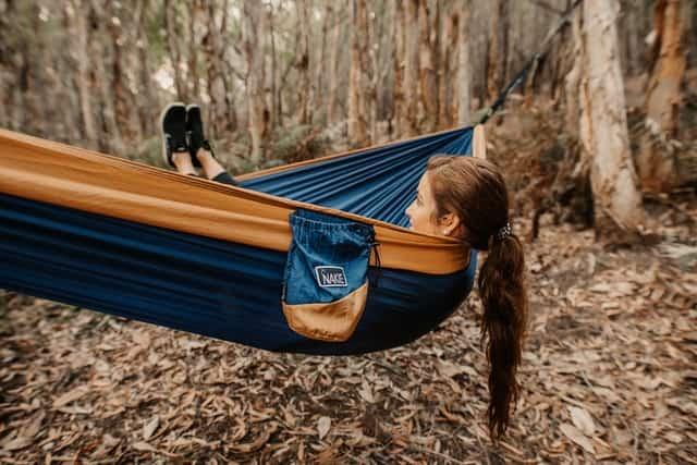 kid camping in a hammock