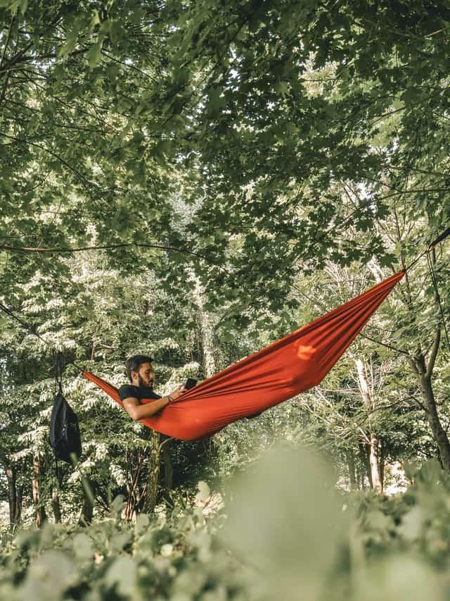 man in camping hammock